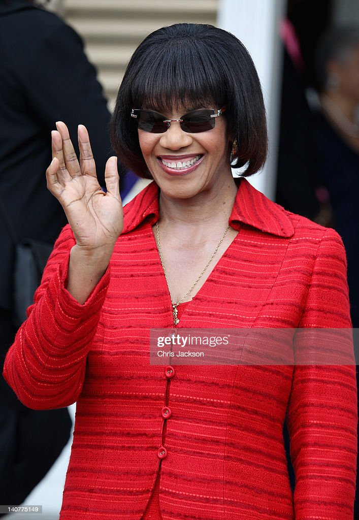 Prime Minister of Jamaica Portia Simpson-Miller smiles on the steps of Devon House on March 6, 2012 in Kingston, Jamaica. Prince Harry is in Jamaica as part of a Diamond Jubilee Tour, representing Queen Elizabeth II, taking in Belize, the Bahamas, Jamaica and Brazil.