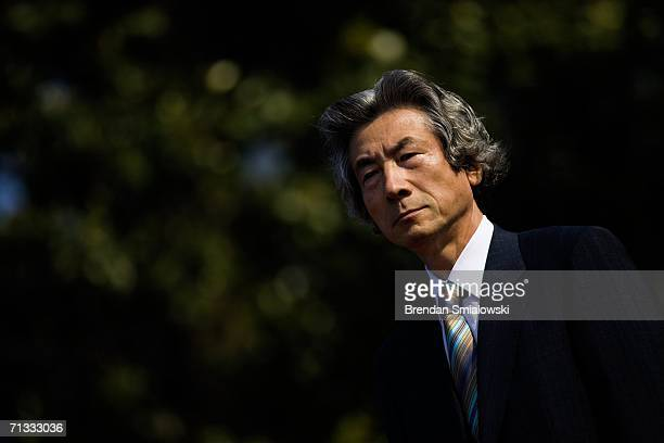Prime Minister of Japan Junichiro Koizumi listens to US President George W Bush speak during an arrival ceremony on the South Lawn of the White House...