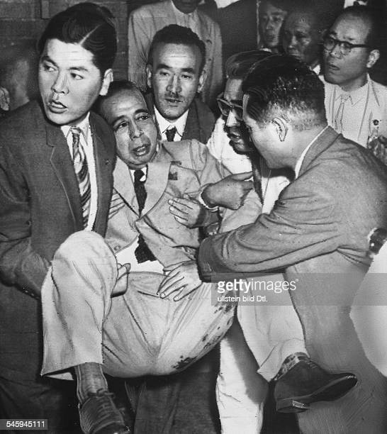 Prime Minister of Japan Nobusuke Kishi after the attempted assassination being tranported to the hospital