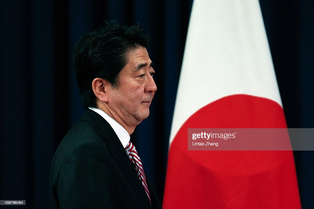 Prime Minister of Japan <a gi-track='captionPersonalityLinkClicked' href=/galleries/search?phrase=Shinzo+Abe&family=editorial&specificpeople=559017 ng-click='$event.stopPropagation()'>Shinzo Abe</a> attend a press conference during the Asia-Pacific Economic Cooperation (APEC) Summit at Chang Fu Gong hotel on November 11, 2014 in Beijing, China. From November 7-11, the APEC 2014 Summit will bring together leaders and senior administration from 21 countries.