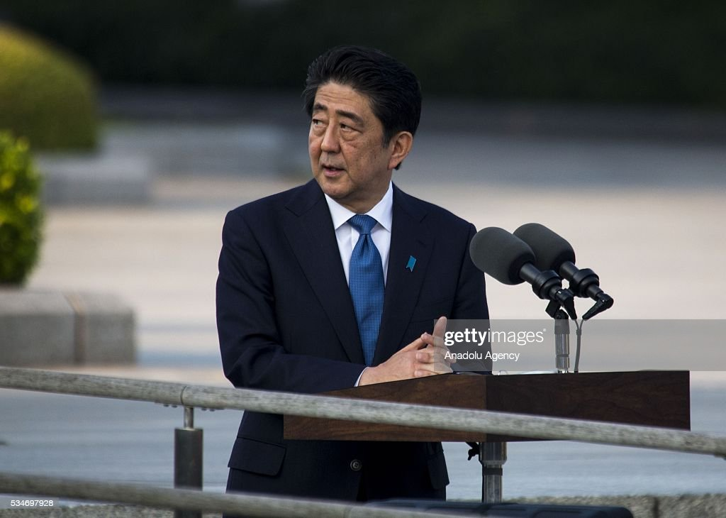 Prime Minister of Japan Shinzo Abe delivers a speech during his visit to the cenotaph at Hiroshima Peace Memorial Park to respect to the families of victims, killed by an atomic bomb in Hiroshima, Japan on May 27, 2016. US President Barack Obama is the first American president, visiting Hiroshima after United States of America dropped Atomic bomb in Hiroshima on August 6, 1945.