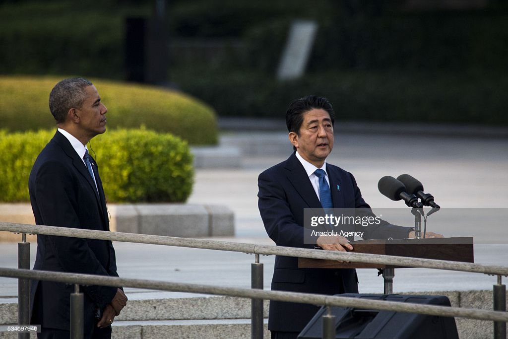 Prime Minister of Japan Shinzo Abe delivers a speech with U.S. President Barack Obama during their visit to the cenotaph at Hiroshima Peace Memorial Park to respect to the families of victims, killed by an atomic bomb in Hiroshima, Japan on May 27, 2016. US President Barack Obama is the first American president, visiting Hiroshima after United States of America dropped Atomic bomb in Hiroshima on August 6, 1945.