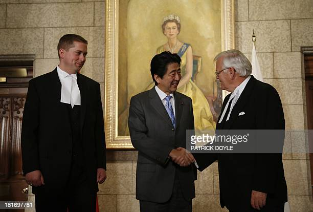 Prime Minister of Japan Shinzo Abe is greeted by Speaker of the Senate Noel Kinsella and Speaker of the House of Commons Andrew Scheer on Parliament...