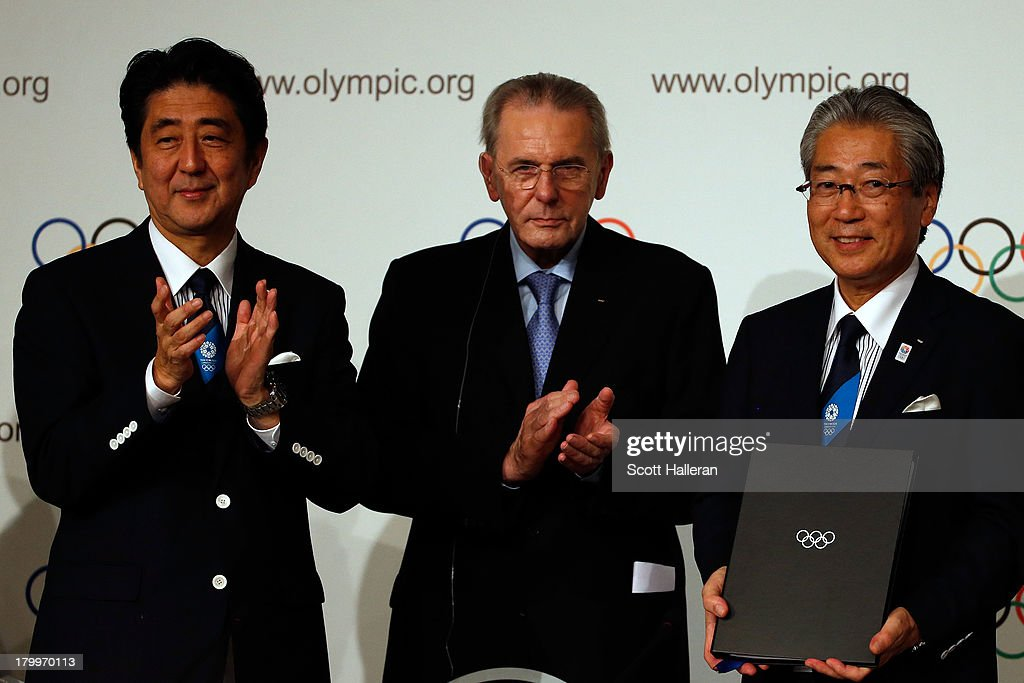 Prime Minister of Japan, Shinzo Abe President of the IOC Jacques Rogge and President of the Tokyo 2020 Committee Tsunekazu Takeda sign the host city contract after Tokyo is awarded the 2020 Summer Olympic Games during the 125th IOC Session - 2020 Olympics Host City Announcement at Hilton Hotel on September 7, 2013 in Buenos Aires, Argentina.