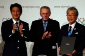 Prime Minister of Japan Shinzo Abe President of the IOC Jacques Rogge and President of the Tokyo 2020 Committee Tsunekazu Takeda sign the host city...