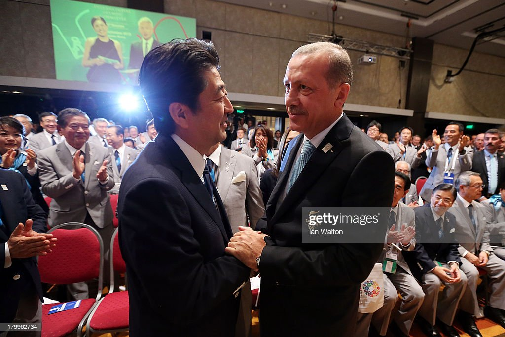 Prime Minister of Japan <a gi-track='captionPersonalityLinkClicked' href=/galleries/search?phrase=Shinzo+Abe&family=editorial&specificpeople=559017 ng-click='$event.stopPropagation()'>Shinzo Abe</a> (L) shakes hands with Prime Minister of Turkey, <a gi-track='captionPersonalityLinkClicked' href=/galleries/search?phrase=Recep+Tayyip+Erdogan&family=editorial&specificpeople=213890 ng-click='$event.stopPropagation()'>Recep Tayyip Erdogan</a> as Tokyo is awarded the 2020 Summer Olympic Gamesduring the 125th IOC Session - 2020 Olympics Host City Announcement at Hilton Hotel on September 7, 2013 in Buenos Aires, Argentina.