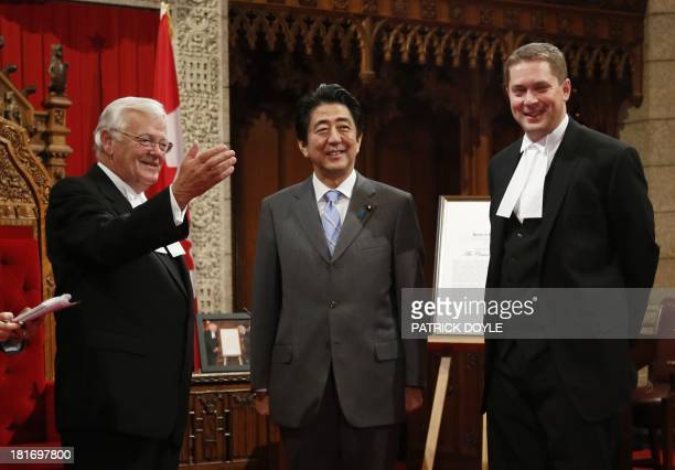 Prime Minister of Japan Shinzo Abe Speaker of the Senate Noel Kinsella and Speaker of the House of Commons Andrew Scheer tour the Senate chamber on...
