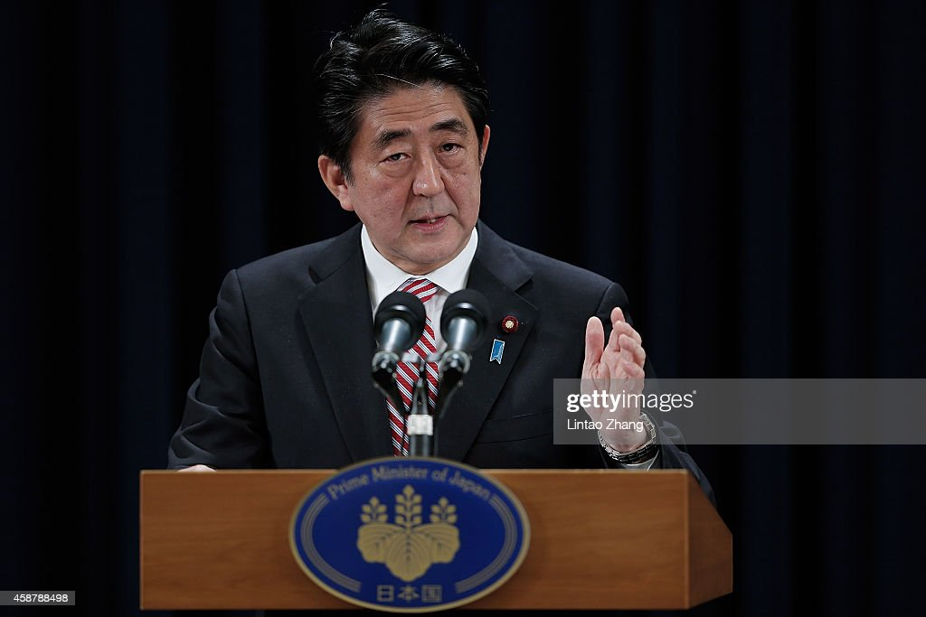 Prime Minister of Japan <a gi-track='captionPersonalityLinkClicked' href=/galleries/search?phrase=Shinzo+Abe&family=editorial&specificpeople=559017 ng-click='$event.stopPropagation()'>Shinzo Abe</a> speaks during a press conference in the Asia-Pacific Economic Cooperation (APEC) Summit at Chang Fu Gong hotel on November 11, 2014 in Beijing, China. From November 7-11, the APEC 2014 Summit will bring together leaders and senior administration from 21 countries.