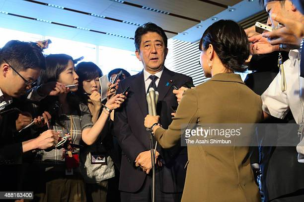 Prime Minister of Japan Shinzo Abe speaks to the press regarding the governments' actions to Mt Aso eruption on September 14 2015 in Aso Japan Mt Aso...