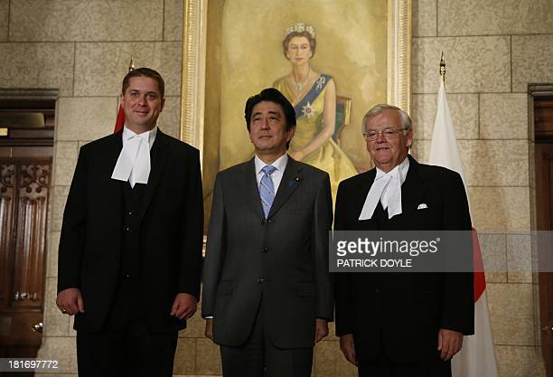 Prime Minister of Japan Shinzo Abe stands with Speaker of the House of Commons Andrew Scheer and Speaker of the Senate Noel Kinsella on Parliament...