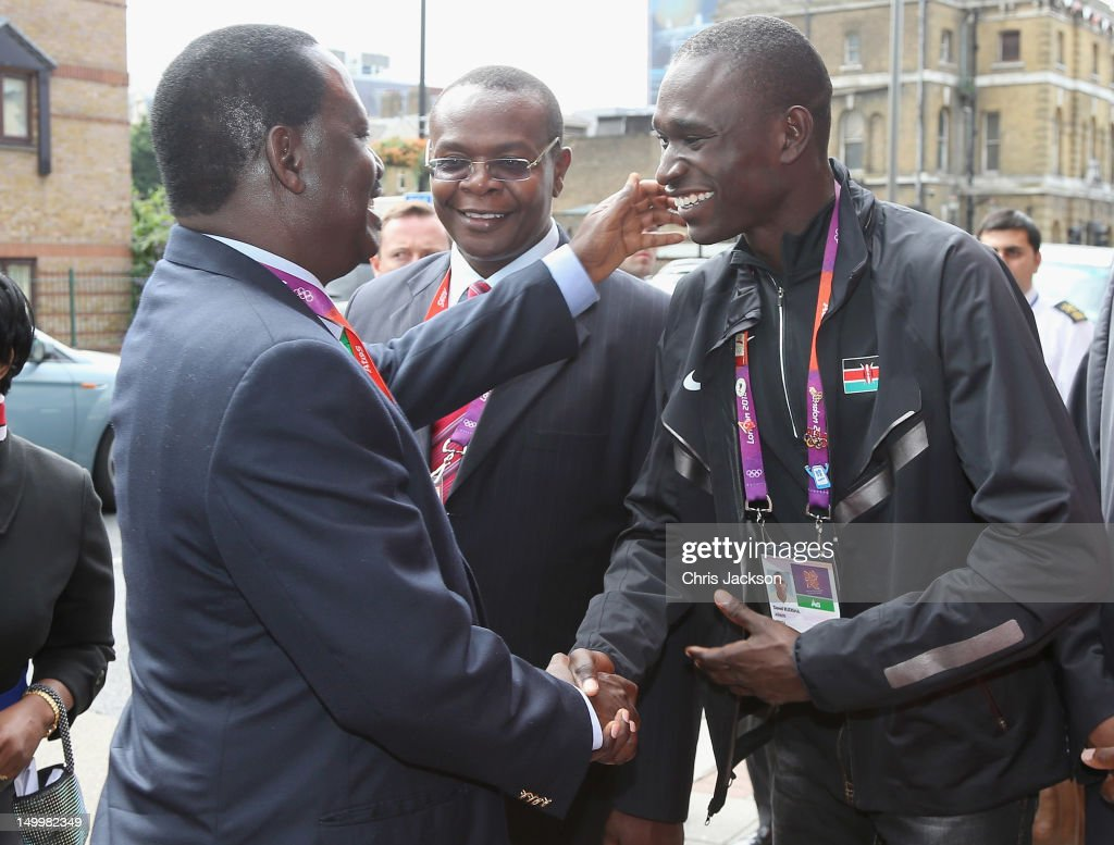 Prime Minister of Kenya, <a gi-track='captionPersonalityLinkClicked' href=/galleries/search?phrase=Raila+Odinga&family=editorial&specificpeople=2147626 ng-click='$event.stopPropagation()'>Raila Odinga</a> greets athlete <a gi-track='captionPersonalityLinkClicked' href=/galleries/search?phrase=David+Rudisha&family=editorial&specificpeople=4398785 ng-click='$event.stopPropagation()'>David Rudisha</a> as he visits Kenya National House on August 8, 2012 in London, England.