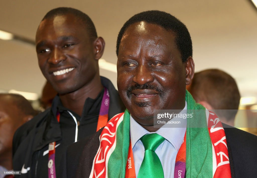 Prime Minister of Kenya, <a gi-track='captionPersonalityLinkClicked' href=/galleries/search?phrase=Raila+Odinga&family=editorial&specificpeople=2147626 ng-click='$event.stopPropagation()'>Raila Odinga</a> smiles next to athlete <a gi-track='captionPersonalityLinkClicked' href=/galleries/search?phrase=David+Rudisha&family=editorial&specificpeople=4398785 ng-click='$event.stopPropagation()'>David Rudisha</a> as he visits Kenya National House on August 8, 2012 in London, England.