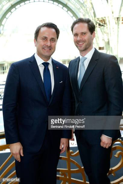 Prime Minister of Luxembourg Xavier Bettel and his husband Architect Gauthier Destenay attend the 'Revelations' Fair at Balcon d'Honneur du Grand...