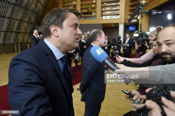 Prime Minister of Luxembourg Xavier Bettel answers journalists' questions as she arrives to take part in the EU summit at the new 'Europa' building...