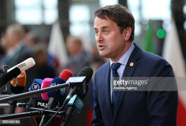 Prime Minister of Luxembourg Xavier Bettel speaks to the media as he arrives to attend the European Union Leaders Summit in Brussels Belgium on March...