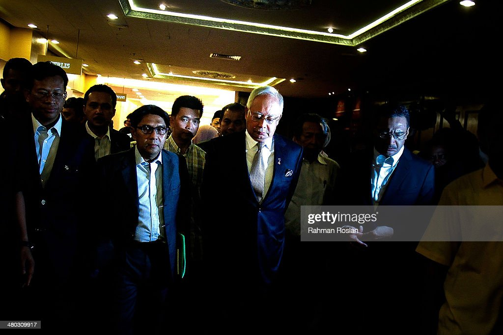 Prime Minister of Malaysia (C), Najib Razak leaves after an ad hoc press conference on March 24, 2014 in Kuala Lumpur, Malaysia. Prime Minister Najib Razak spoke at the press conference to announce that fresh analysis of available satellite data has concluded that missing flight MH370's final position was in the southern Indian Ocean. French authorities reported a satellite sighting of objects in an area of the southern Indian Ocean where China and Australia have also reported similar sightings of potential debris from the flight that went missing on March 8.