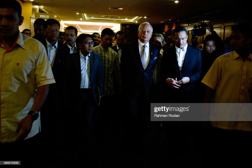Prime Minister of Malaysia, Najib Razak leaves after an ad hoc press conference on March 24, 2014 in Kuala Lumpur, Malaysia. Prime Minister Najib Razak spoke at the press conference to announce that fresh analysis of available satellite data has concluded that missing flight MH370's final position was in the southern Indian Ocean. French authorities reported a satellite sighting of objects in an area of the southern Indian Ocean where China and Australia have also reported similar sightings of potential debris from the flight that went missing on March 8.