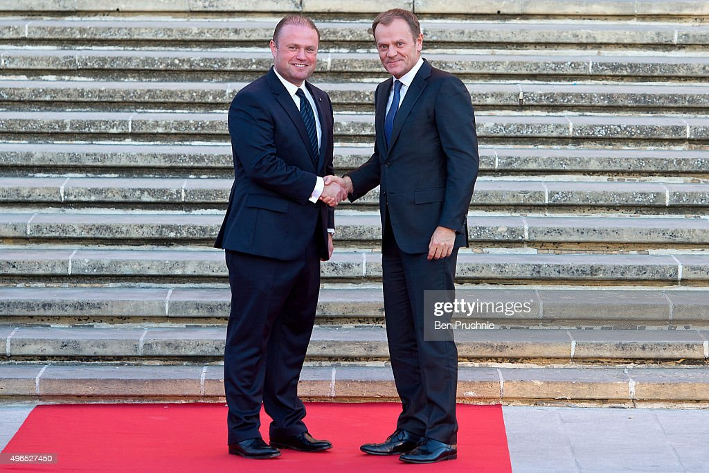 Prime Minister of Malta <a gi-track='captionPersonalityLinkClicked' href=/galleries/search?phrase=Joseph+Muscat&family=editorial&specificpeople=10541380 ng-click='$event.stopPropagation()'>Joseph Muscat</a> (L) greets President of the European Council <a gi-track='captionPersonalityLinkClicked' href=/galleries/search?phrase=Donald+Tusk&family=editorial&specificpeople=870281 ng-click='$event.stopPropagation()'>Donald Tusk</a> (R) at the Auberge de Castille ahead of the Valletta Summit on migration on November 10, 2015 in Valletta, Malta. The Summit will bring together representatives from the European Union and African countries to address the challenges and opportunities of the largest migration of people to Europe since World War II.