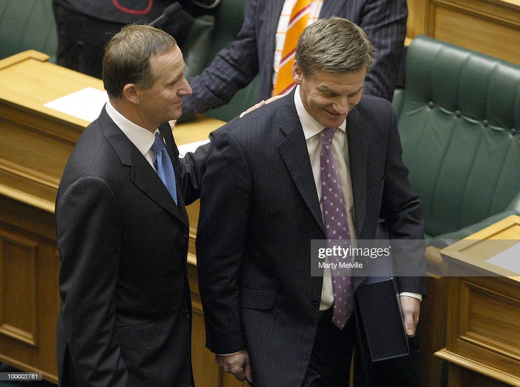 Prime Minister of New Zealand John Key (L) walks into the chamber with Minister of Finance Bill English before the reading of the Budget in Parliament House on May 20, 2010 in Wellington, New Zealand. English announced tax cuts across the board, with all income tax rates to be cut from October this year and company tax rates from April next year.