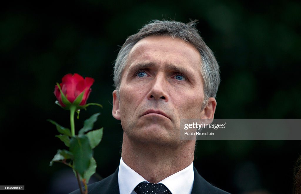 Prime Minister of Norway Jens Stoltenberg holds a rose as thousands of people gather at a memorial vigil following Friday's twin extremist attacks on July 25 ,2011 in Oslo, Norway. Anders Behring Breivik, 32, claimed that he has 'two more cells' working with him as he appeared in court today following a bomb blast at a government building in Oslo and a shooting massacre on nearby Utoya Island that killed at least 76 people in all. The death toll was originally reported as 93. Breivik has been detained for eight weeks, four of which in full isolation.