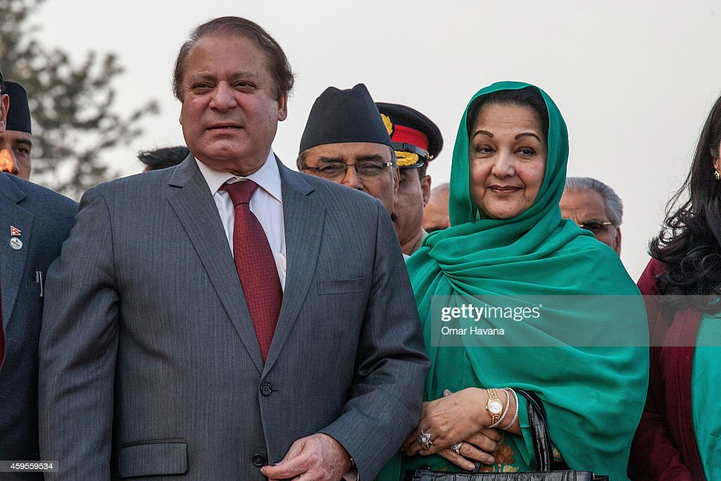 Prime Minister of Pakistan <a gi-track='captionPersonalityLinkClicked' href=/galleries/search?phrase=Nawaz+Sharif&family=editorial&specificpeople=217726 ng-click='$event.stopPropagation()'>Nawaz Sharif</a> poses with his wife Kalsoom <a gi-track='captionPersonalityLinkClicked' href=/galleries/search?phrase=Nawaz+Sharif&family=editorial&specificpeople=217726 ng-click='$event.stopPropagation()'>Nawaz Sharif</a> upon his arrival for the 18th SAARC Summit on November 25, 2014 in Kathmandu, Nepal. On 26-27 November, Nepal will be hosting the 18th South Asian Association for Regional Cooperation (SAARC) Summit in Kathmandu, which will be attended by leaders of Nepal, Afghanistan, Bangladesh, Pakistan, India, the Maldives, Sri Lanka and Bhutan. Nepal is hosting the SAARC Summit for the third time, which was first held in Dhaka, Bangladesh in 1985. Some of the main issues to be discussed during the summit will include three key framework agreements between SAARC countries to enhance rail and road connectivity and to set up a regional power grid.