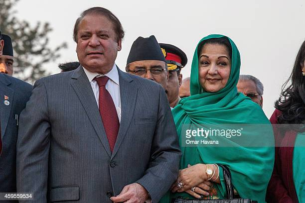 Prime Minister of Pakistan Nawaz Sharif poses with his wife Kalsoom Nawaz Sharif upon his arrival for the 18th SAARC Summit on November 25 2014 in...
