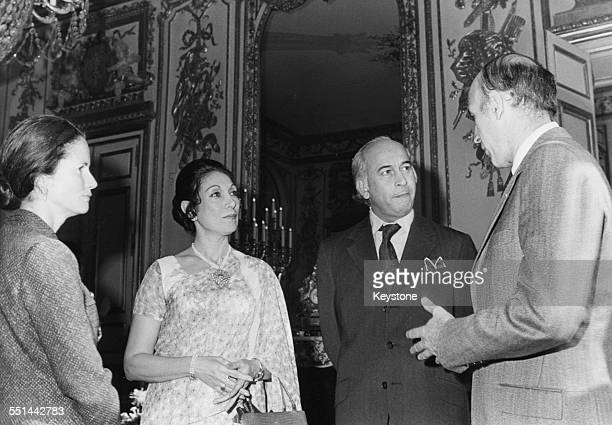 Prime Minister of Pakistan Zulfikar Ali Bhutto and French President Valery Giscard D'Estaing with their wives talking at the Elysee Palace Paris...