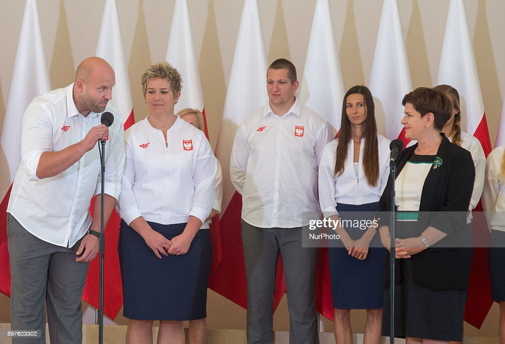 Prime Minister of Poland Beata Szydlo Anita Wlodarczyk and Piotr Malachowski during the with Olympic medalists from Rio in Warsaw Poland on 29 August...