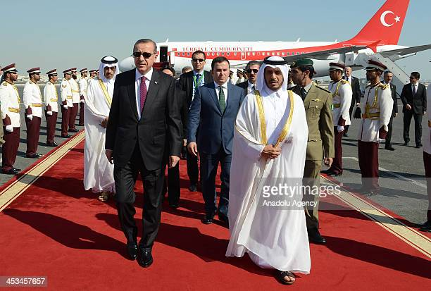 Prime Minister of Qatar Abdullah bin Nasser bin Khalifa Al Thani welcomes Turkish Prime Minister Recep Tayyip Erdogan on December 4 2013 in Qatar