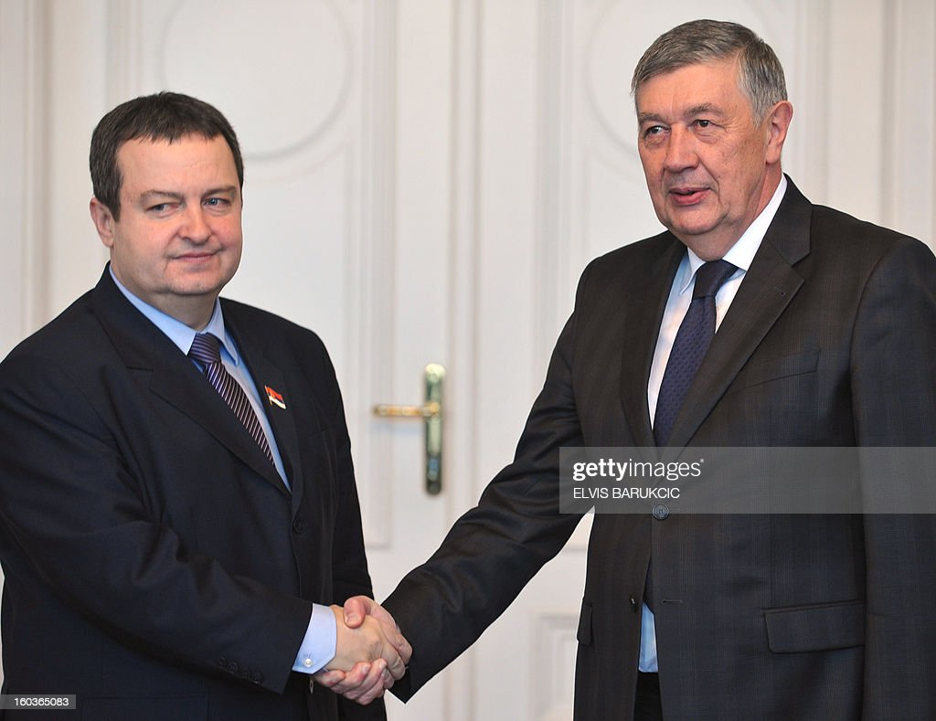 Prime Minister of Serbia, Ivica Dacic (L) and Chairman of Bosnia's tripartite Presidency, Nebojsa Radmanovic (R) shake hands before bi-lateral meeting in Sarajevo, on January 30, 2013. AFP PHOTO ELVIS BARUKCIC