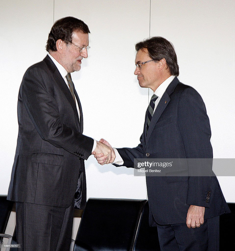 Prime Minister of Spain Mariano Rajoy and President of Catalonia <a gi-track='captionPersonalityLinkClicked' href=/galleries/search?phrase=Artur+Mas&family=editorial&specificpeople=712829 ng-click='$event.stopPropagation()'>Artur Mas</a> at Barcelona Sants train station during the inauguration of the AVE high-speed train line between Barcelona and the French border on January 8, 2013 in Barcelona, Spain.