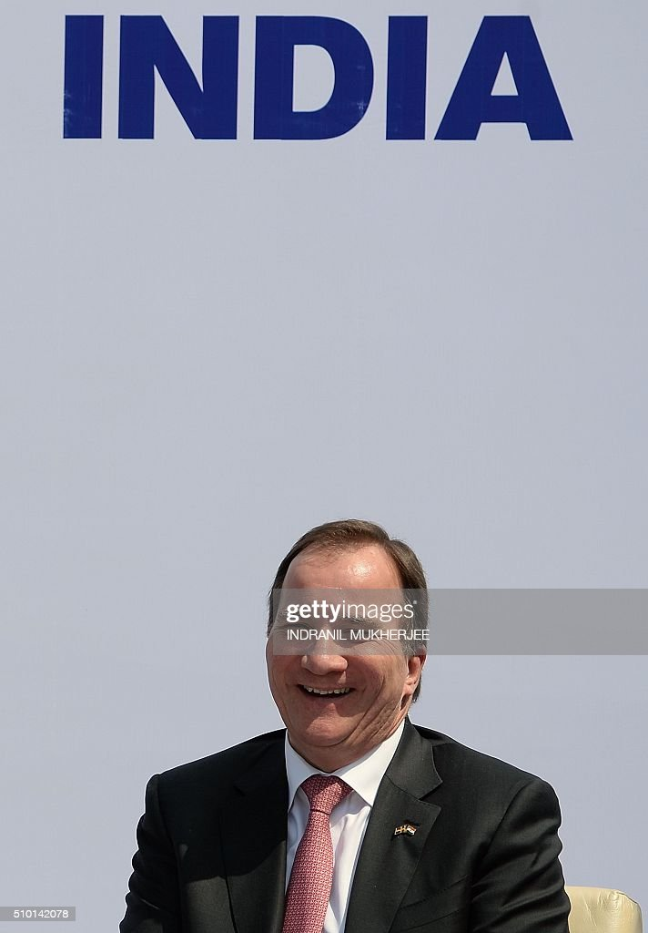 Prime Minister of Sweden Stefan Lofven smiles during the introduction of the first Volvo hybrid city bus made in India on the sidelines of the 'Make in India Week' in Mumbai on February 14, 2016. Over 190 companies, and 5,000 delegates from 60 countries, are taking part in the first 'Make in India' week held in Mumbai from February 13-18. AFP PHOTO/ INDRANIL MUKHERJEE / AFP / INDRANIL MUKHERJEE