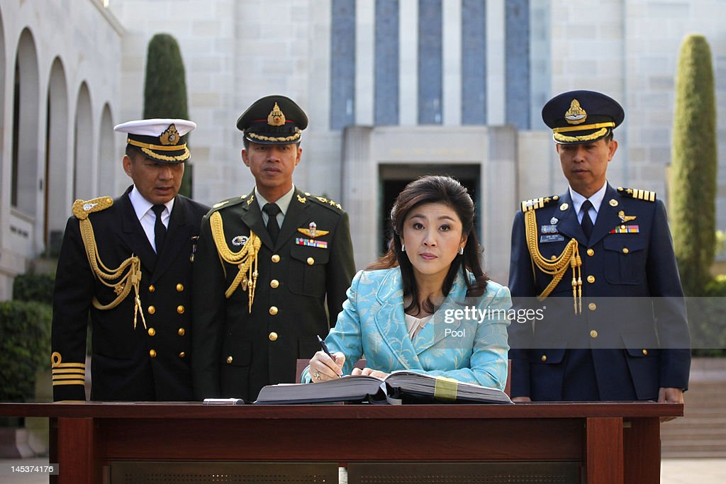 Prime Minister of Thailand, Ms <a gi-track='captionPersonalityLinkClicked' href=/galleries/search?phrase=Yingluck+Shinawatra&family=editorial&specificpeople=787330 ng-click='$event.stopPropagation()'>Yingluck Shinawatra</a> signs the visitors book during her visit to the Australian War Memorial on May 28, 2012 in Canberra, Australia. Prime Minister Shinawatra is visiting Australia to mark 60 years of diplomatic relation between Thailand and Australia and will hold meetings in Canberra and Sydney to discuss trade and tourism.