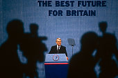 Prime Minister of the day John Major is under the scrutiny of media TV cameras during the 1991 Tory party conference The silhouettes of two TV...