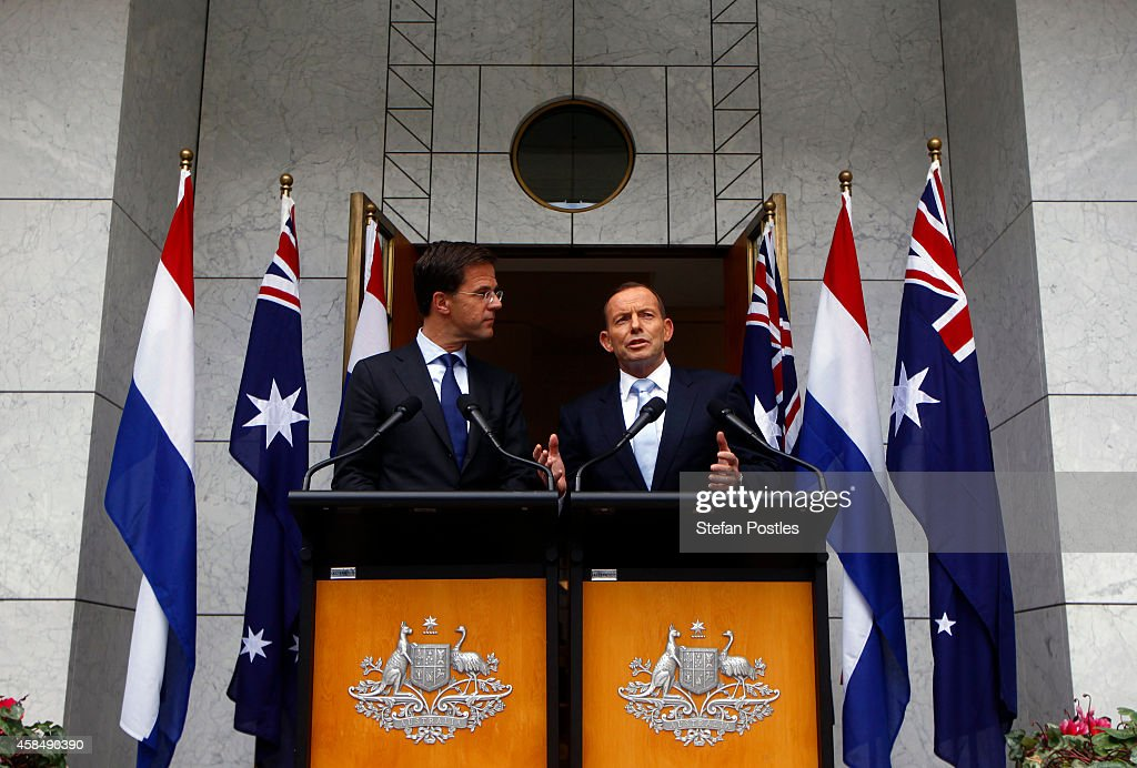 Prime Minister of The Netherlands <a gi-track='captionPersonalityLinkClicked' href=/galleries/search?phrase=Mark+Rutte&family=editorial&specificpeople=4509362 ng-click='$event.stopPropagation()'>Mark Rutte</a> (L) listens to Australian Prime Minster <a gi-track='captionPersonalityLinkClicked' href=/galleries/search?phrase=Tony+Abbott&family=editorial&specificpeople=220956 ng-click='$event.stopPropagation()'>Tony Abbott</a> speak during a media conference at Parliament House November 6, 2014 in Canberra, Australia. Rutte is on a two-day official visit to Australia and will discuss with his Australian counterpart the downing of Malaysia Airlines flight MH17 over Ukraine in July.