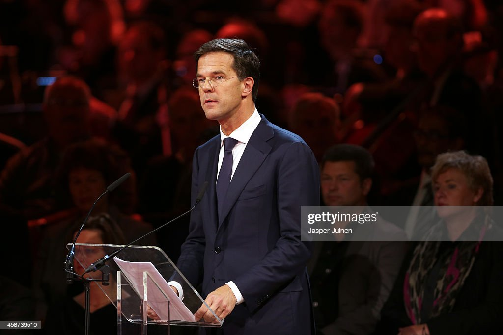 Prime Minister of the Netherlands <a gi-track='captionPersonalityLinkClicked' href=/galleries/search?phrase=Mark+Rutte&family=editorial&specificpeople=4509362 ng-click='$event.stopPropagation()'>Mark Rutte</a> speaks as relatives and friends of the victims of the Malaysia Airlines Flight 17 disaster attend a national commemoration ceremony at RAI on November 10, 2014 in Amsterdam, Netherlands. Hundreds of grieving family members and friends are gathering in Amsterdam for a national commemoration ceremony nearly four months after the passenger jet was downed over eastern Ukraine killing all 298 people on board. The Boeing 777 was downed July 17 while flying from Amsterdam to Kuala Lumpur.