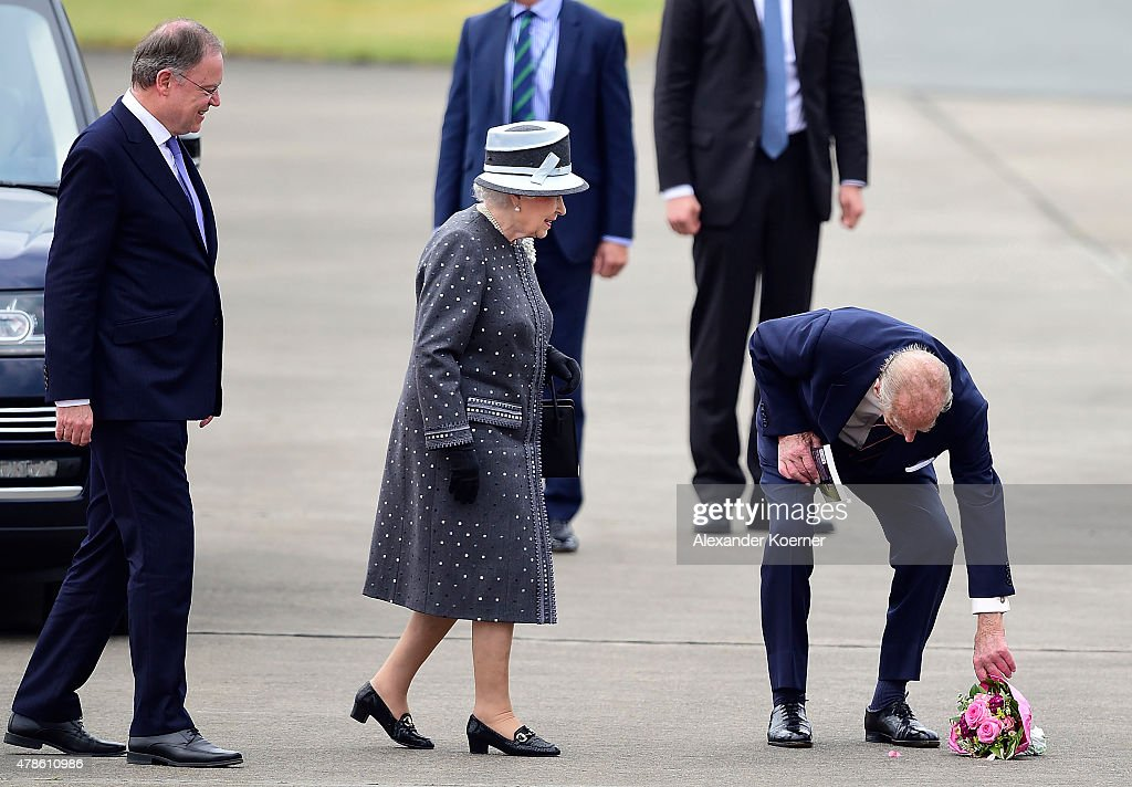 Prime Minister of the state of Lower Saxony Stephan Weil (L), Queen Elizabeth II and Prince Philip, Duke of Edinburgh, arrive at the military airport of Celle on June 26, 2015 in Celle, Germany. The Royal couple visited the concentration camp memorial at Bergen-Belsen this morning. This is the final day of a four day state visit, which is their first to Germany since 2004.