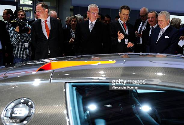 Prime Minister of the State of Lower Saxony Stephan Weil Volkswagen Group CEO Martin Winterkorn and Wolfgang Porsche are seen at a Bugatti stand...