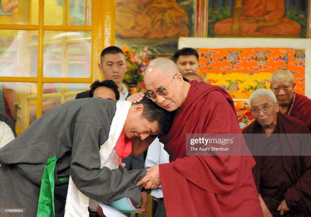 Prime Minister (Kalon Tripa) of the Tibetan Government in Exile <a gi-track='captionPersonalityLinkClicked' href=/galleries/search?phrase=Lobsang+Sangay&family=editorial&specificpeople=7725923 ng-click='$event.stopPropagation()'>Lobsang Sangay</a> (L) is celebrated by Tibetan spiritual leader Dalai Lama after sworn in on August 8, 2011 in Dharamsala, India.