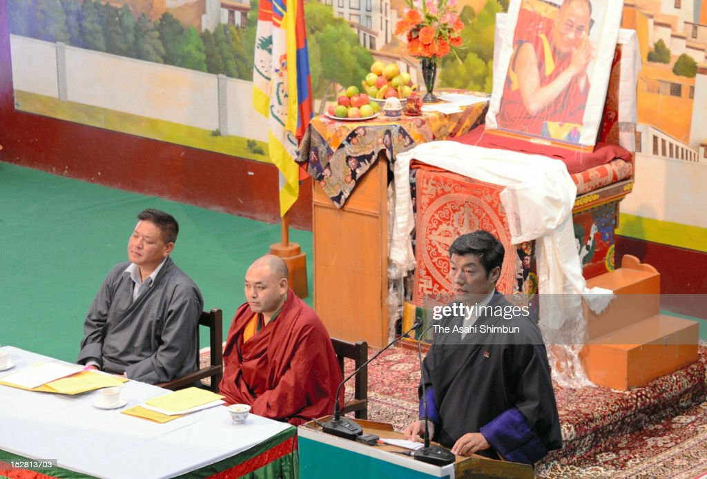 Prime Minister (Kalon Tripa) of the Tibetan Government in Exile <a gi-track='captionPersonalityLinkClicked' href=/galleries/search?phrase=Lobsang+Sangay&family=editorial&specificpeople=7725923 ng-click='$event.stopPropagation()'>Lobsang Sangay</a> (R) addresses during the Special General Meeting on September 25, 2012 in Dharamsala, India. During the meeting, 400 representatives discuss on the increasing number of Tibetan monks' self-immolations to protest against China.