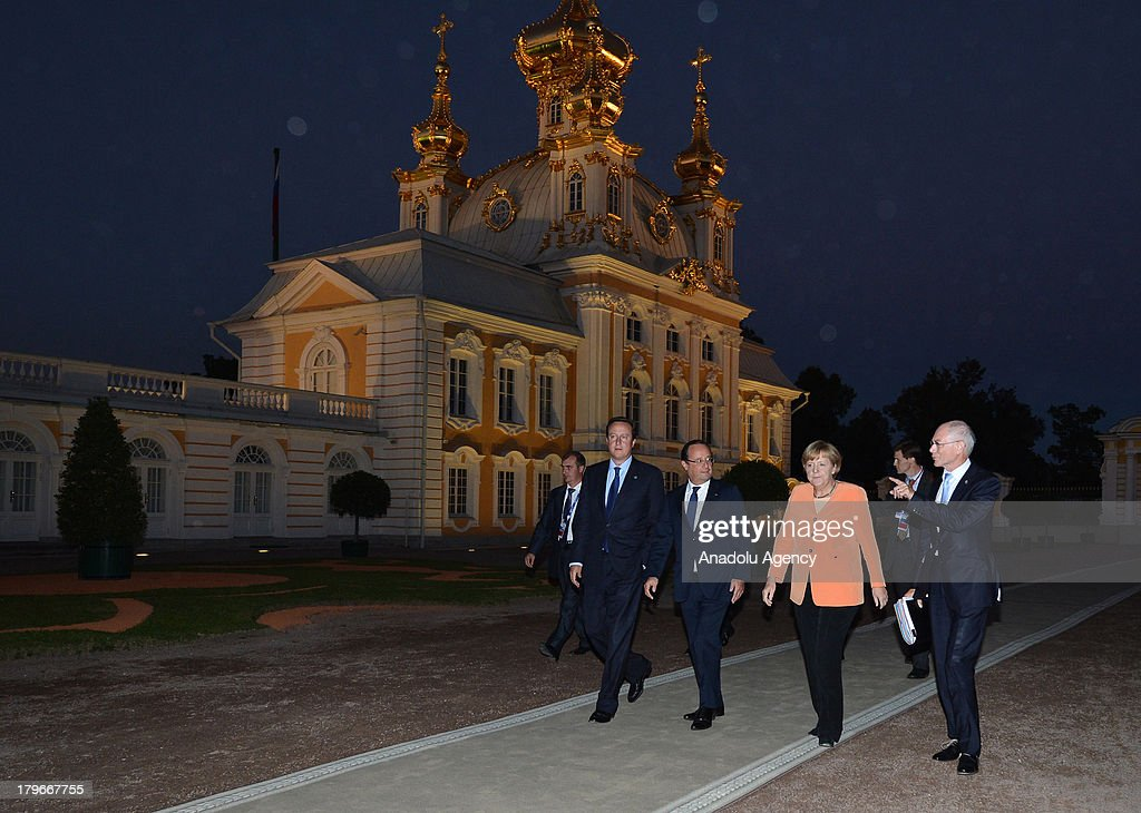 Prime Minister of the United Kingdom David Cameron (L), French President Francois Hollande (2nd R) Germany's Chancellor Angela Merkel (2nd R) and European Council President Herman Van Rompuy (R) walk with other G-20 leaders for the dinner at the Peterhof Palace in St. Petersburg, Russia on Thursday, September 5, 2013. World leaders are expected to discuss Syria at the dinner. The G20 summit begins on September 5, 2013 in Strelna town of Saint Petersburg under Russian Presidency.