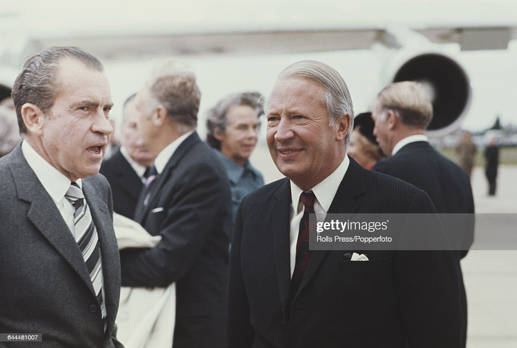 Prime Minister of the United Kingdom Edward Heath greets President of the United States Richard Nixon as he arrives at London's Heathrow airport for...