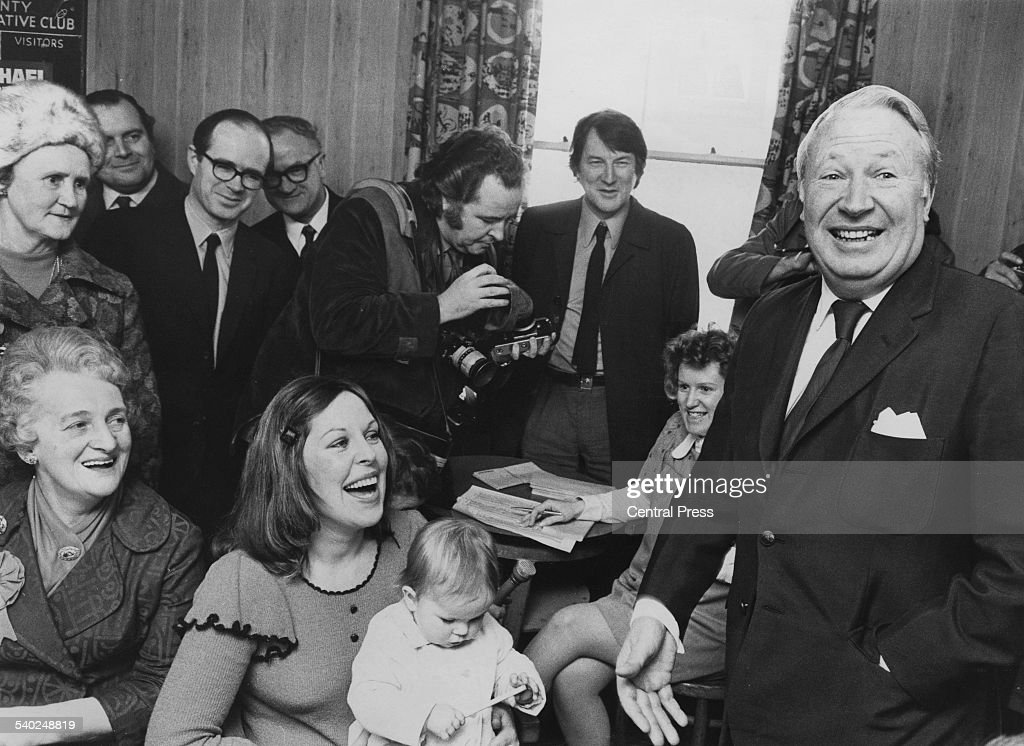 Prime Minister of the United Kingdom Edward Heath (1916 - 2005) meets 10-month-old Lucy Barton-Greenwood during his visit to Cardiff on the Election campaign, 14th February 1978.