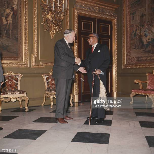 Prime Minister of the United Kingdom Harold Wilson on left shakes hands with Hastings Banda President of Malawi at the 1969 Commonwealth Prime...