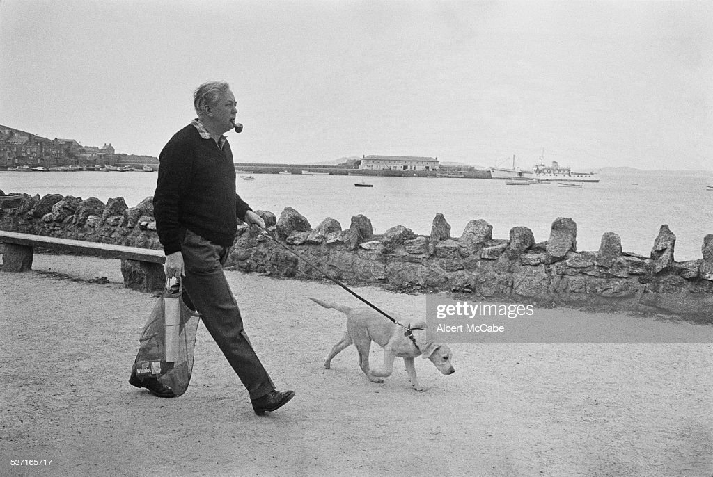 Prime Minister of the United Kingdom Harold Wilson (1916 - 1995) with his dog 'Paddy' on holiday on the Isles of Scilly, Great Britain, 1967.