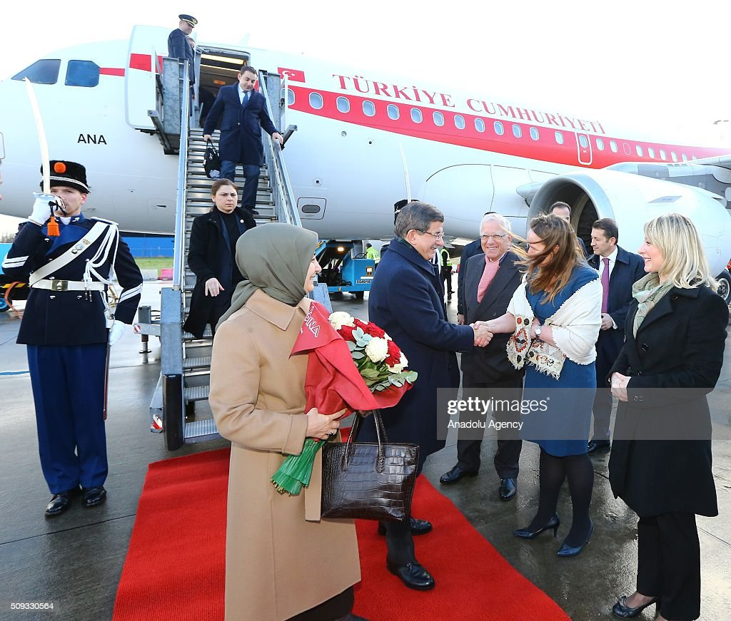 Prime Minister of Turkey, Ahmet Davutoglu (2nd L) and his spouse Sare Davutoglu (L) leaves the official plane after landing The Hague Airport in Rotterdam, Netherlands on February 10, 2016.