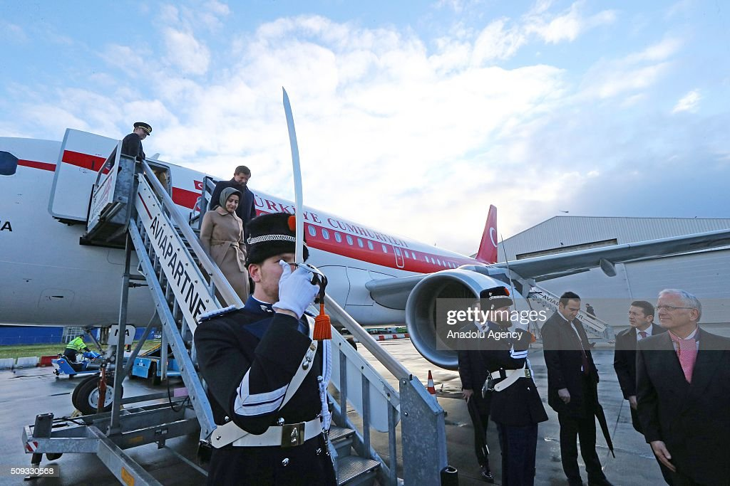 Prime Minister of Turkey, Ahmet Davutoglu (R) and his spouse Sare Davutoglu (L) leaves the official plane after landing The Hague Airport in Rotterdam, Netherlands on February 10, 2016.