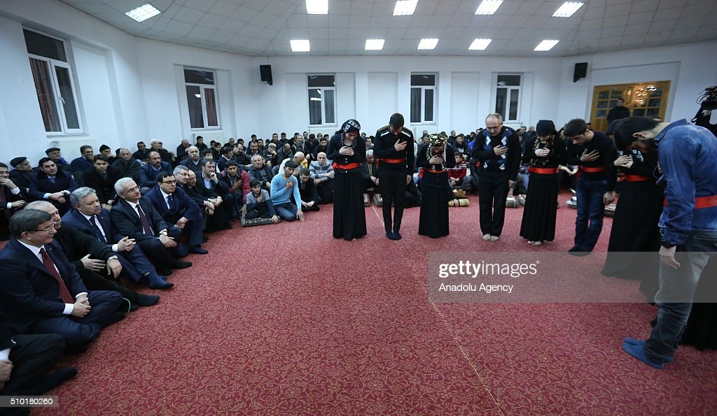 Prime Minister of Turkey, Ahmet Davutoglu (L) attend a 'Semah' prayer mass as he visits Haci Bektai Veli Anadolu Cultural Foundation where also hosts a 'Cemevi' in Erzincan, Turkey on February 14, 2016. Cemevi is a holy place where Alawites, a branch of Islam, gathers and pray.