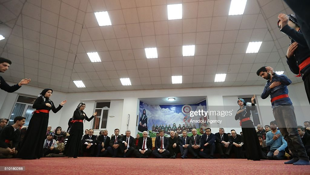 Prime Minister of Turkey, Ahmet Davutoglu (6th L) attend a 'Semah' prayer mass as he visits Haci Bektai Veli Anadolu Cultural Foundation where also hosts a 'Cemevi' in Erzincan, Turkey on February 14, 2016. Cemevi is a holy place where Alawites, a branch of Islam, gathers and pray.