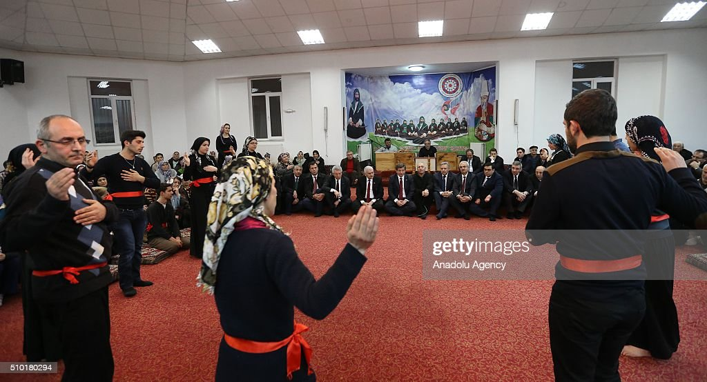 Prime Minister of Turkey, Ahmet Davutoglu (5th L) attend a 'Semah' prayer mass as he visits Haci Bektai Veli Anadolu Cultural Foundation where also hosts a 'Cemevi' in Erzincan, Turkey on February 14, 2016. Cemevi is a holy place where Alawites, a branch of Islam, gathers and pray.